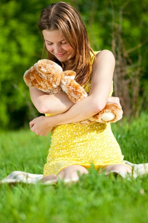 Beautiful young woman play with lovely toy bear Stock Photo - 9633268