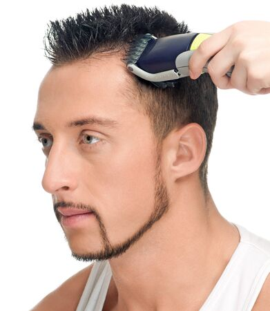 Close up portrait of young handsome man with perfect skin and hair. Cutting hairs. Stock Photo - 9633093