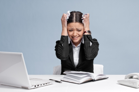 Sad business woman in office working with white table, laptop and diary personal organizer. Problem! photo