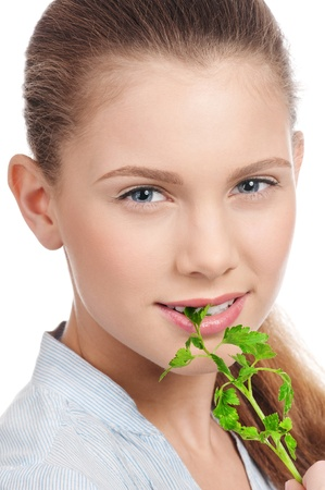 Young beauty woman with green parsley isolated on white photo