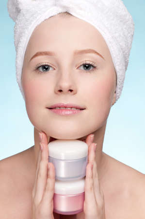 Beautiful woman tender jar of moisturizer cream. Close-up fresh young woman face Stock Photo - 9672420