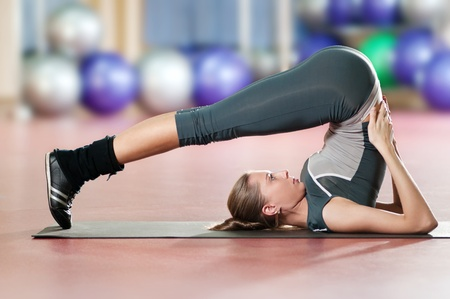 Beautiful sport woman doing stretching fitness exercise at sport gym. Yoga  Stock Photo - 9805876