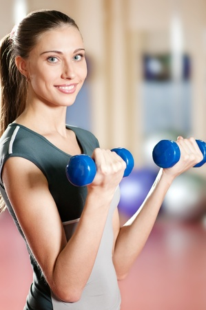 Woman with dumbbell photo