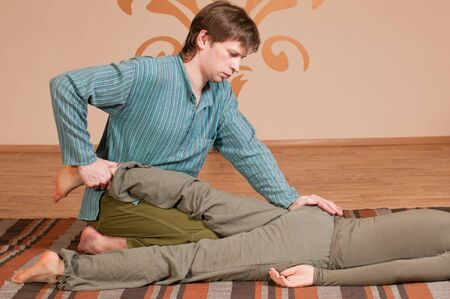 Two young man and woman couple doing yoga. Massage Stock Photo - 9839345