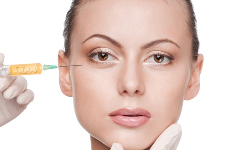 Cosmetic botox injection in the female face. Eye zone. Isolated photo