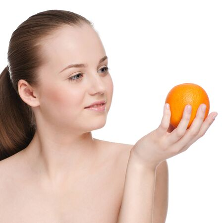 Young woman eat green apple and orange Stock Photo - 9838892