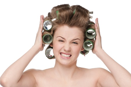 beautiful woman curling her hair with roller Stock Photo - 9839248