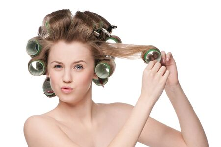 beautiful woman curling her hair with roller Stock Photo - 9839222