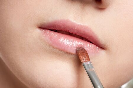 Close-up face of beauty young woman - lips make-up zone photo