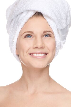 Closeup portrait of young beautiful happy girl with perfect skin and towel on head. Smile photo