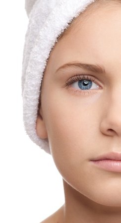 Closeup shoot of half face young beautiful girl with perfect skin and white towel on head