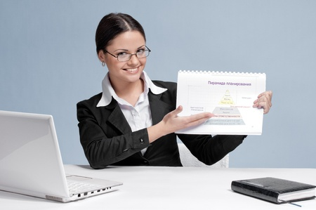 Emotional business woman in office palce show color chart. Smile presentation photo