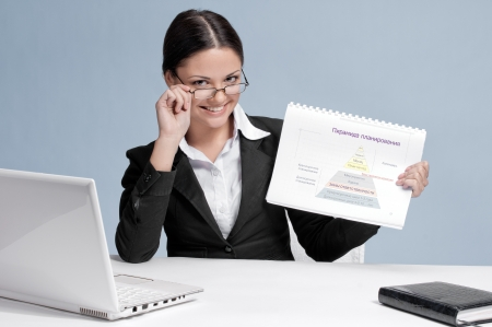 Emotional business woman with glasses in office palce show color chart. Smile. photo