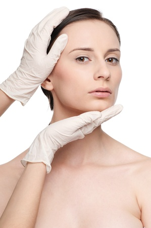 Beautician touch and exam health woman face. Plastic surgery. Isolated Stock Photo - 10000002