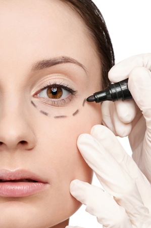 Beautician touch and draw correction lines on woman face. Before plastic surgery operetion. Isolated Stock Photo - 10000062