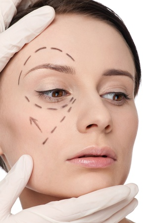 Beautician touch and draw correction lines on woman face. Before plastic surgery operetion. Isolated Stock Photo - 10000072
