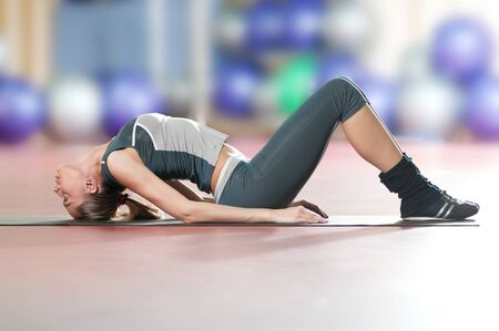 Beautiful sport woman doing stretching fitness exercise at sport gym. Yoga Stock Photo - 9999895