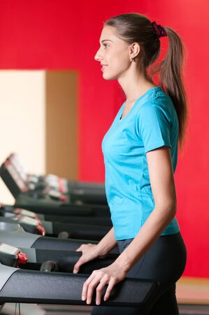 Young woman at the gym exercising. Run on on a machine. Stock Photo - 10000069