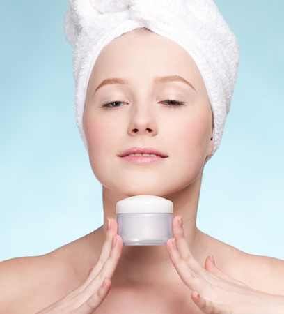 Beautiful woman tender jar of moisturizer cream. Close-up fresh young woman face Stock Photo - 9999912