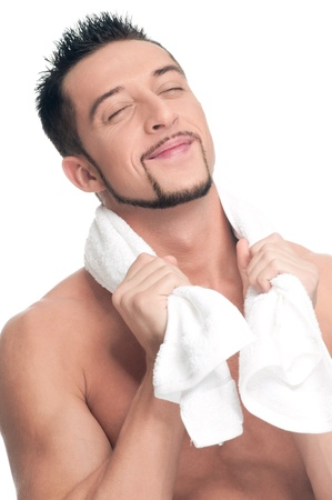 Close up portrait of young handsome dream man with perfect skin and towel. Isolated on white Stock Photo