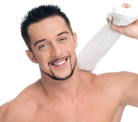 hand towel: Close up portrait of young happy man face with perfect skin and towel. Isolated on white