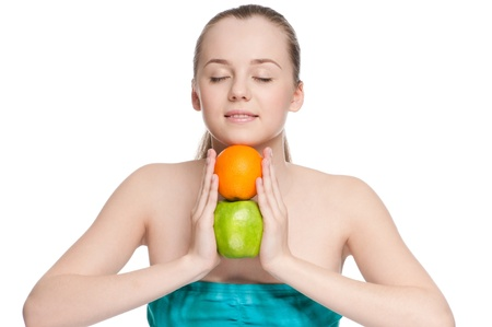 Young woman eat green apple and orange photo