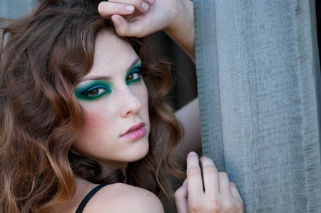 Beautiful fashion woman with green  make-up and perfect skin posing at old rural location Stock Photo - 10055682