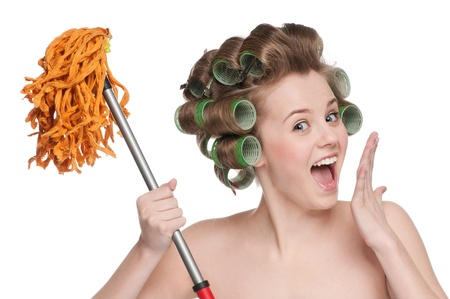 Angry crazy housewife in hair rollers is holding swab photo