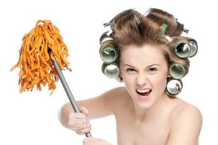 Angry crazy housewife in hair rollers is holding swab Stock Photo - 10203905