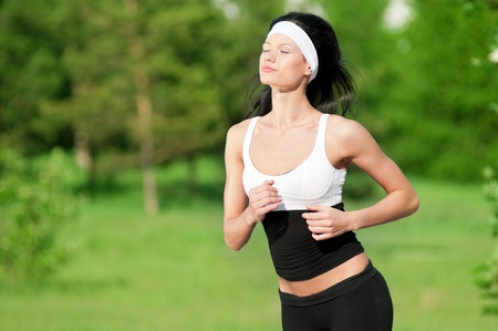 Woman running on a summer day Stock Photo