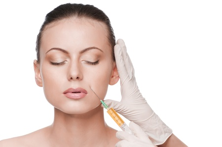 rejuvenate: Cosmetic botox injection in the female face. Lips zone. Isolated