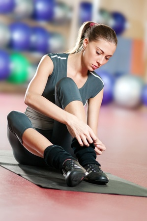 indoor sport: Beautiful sport woman doing stretching fitness exercise at sport gym. Yoga