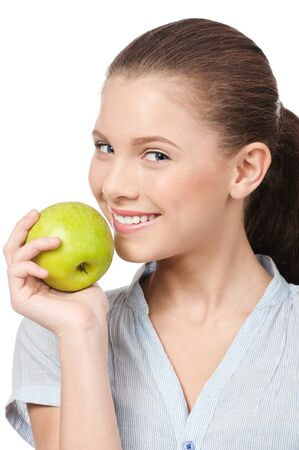 Young beauty woman with green apple isolated on white photo