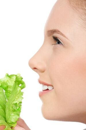 Young beauty woman with green lettuce isolated on white Stock Photo - 10525339
