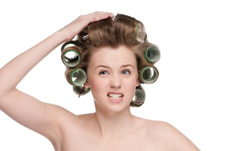 hair roller: beautiful woman curling her hair with roller
