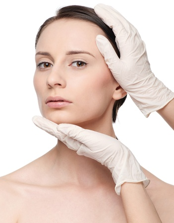 Beautician touch and exam health woman face. Plastic surgery. Isolated photo
