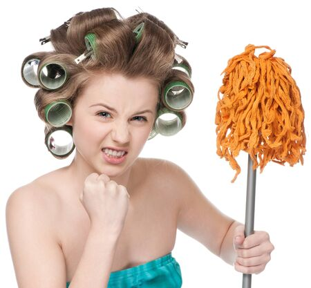Angry crazy housewife in hair rollers is holding swab Stock Photo - 10583007