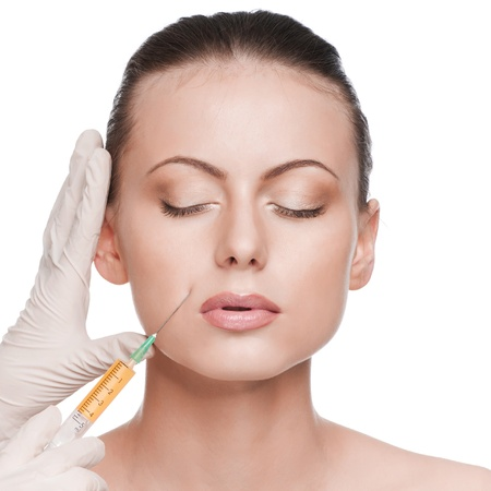 Cosmetic botox injection in the female face. Lips zone. Isolated photo