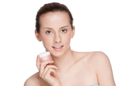 Beautiful woman tender jar of moisturizer cream Stock Photo - 10723865