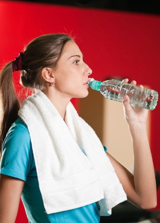 Portrait of a woman at the gym drinking water stock photo picture portrait of a woman at the gym drinking water stock photo picture and royalty free image image 10953471 sciox Gallery