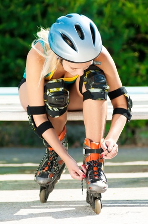 roller blade: happy young woman on roller skates in the park Stock Photo