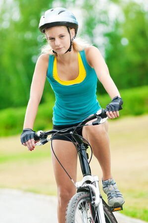 gloves women: Portrait of pretty young woman with bicycle in a park - outdoor