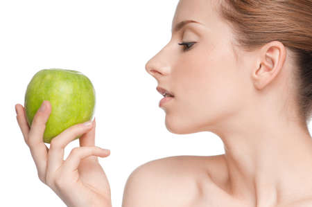 Young woman eat green apple Stock Photo - 11177939
