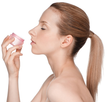 Young beautiful girl smell cream jar Stock Photo - 11286117
