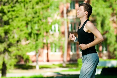 Young man jogging in park. Health and fitness. Stock Photo - 11286040