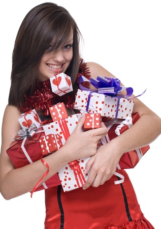 Emotional playful woman  in santa claus dress, white fur and some gifts photo