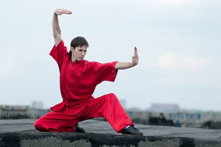 Shaolin warriors wushoo man in red practice martial art outdoor. Kung fu Stock Photo - 11468772