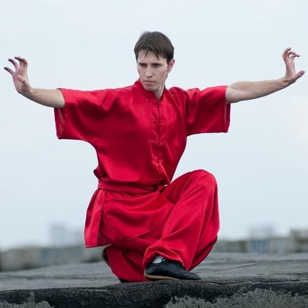 Shaolin warriors wushoo man in red practice martial art outdoor. Kung fu Stock Photo - 11468281