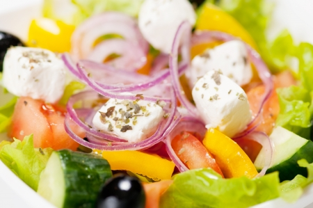 Macro shot of greek salad on the white background  photo