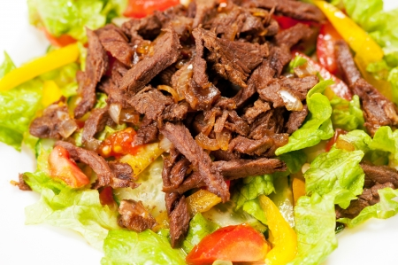 meat dish: Macro shot of spice Mexican salad with meat on white plate  Stock Photo